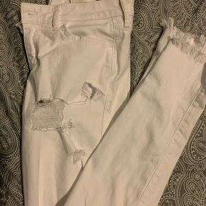 White distressed super skinny jeans